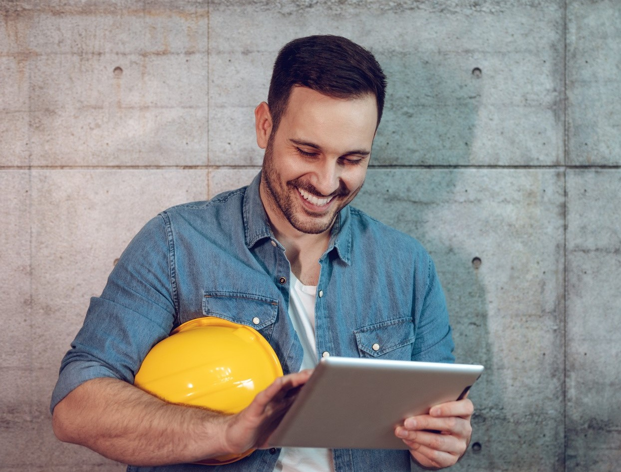 Man using ERP rental software on a tablet