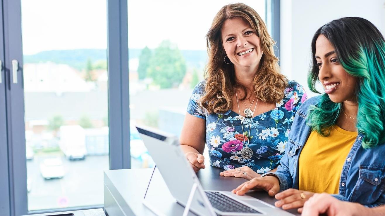 Businesswomen working with Microsoft Flow